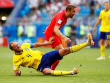 England's Harry Kane in action with Sweden's Andreas Granqvist on July 7, 2018