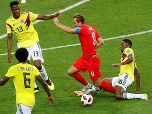 England overcome penalty hoodoo to reach quarters