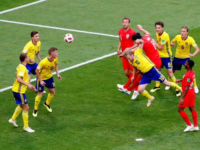 England's Harry Maguire scores their first goal against Sweden on July 7, 2018