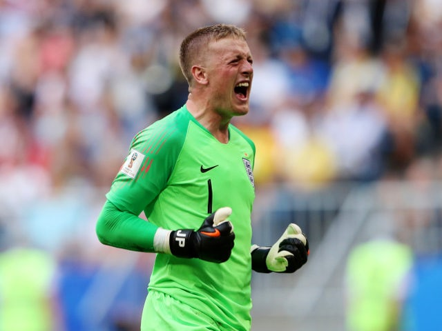 England's Jordan Pickford celebrates after Harry Maguire scored their first goal against Sweden on July 7, 2018