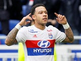 Lyon's Memphis Depay celebrates scoring their first goal against Nantes on April 28, 2018