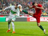 Portugal's Goncalo Guedes in action with Algeria's Ramy Bensebaini on June 7, 2018