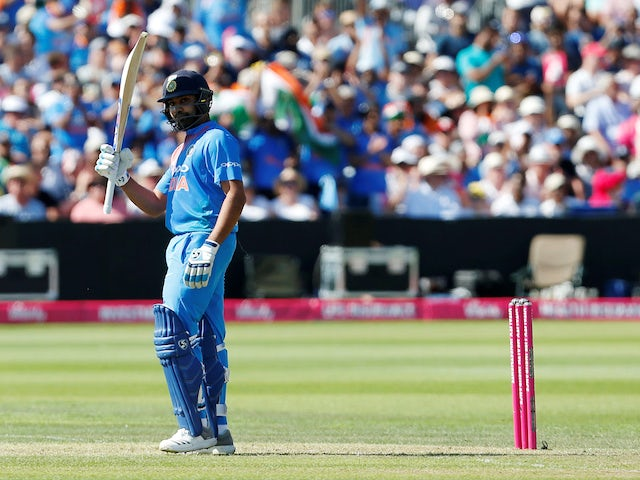 India's Rohit Sharma celebrates on his way to 100 during the T20 match against England on July 8, 2018