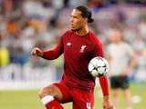 Liverpool defender Virgil van Dijk warms up ahead of the 2018 Champions League final with Real Madrid