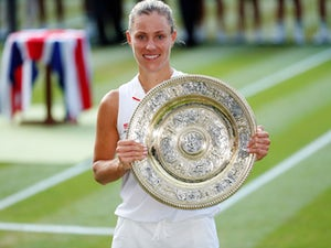 Germany's Angelique Kerber celebrates winning the Wimbledon women's singles final with the trophy on July 14, 2018