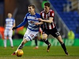 Reading's Jon Dadi Bodvarsson in action with Brentford's Chris Mepham on January 20, 2018
