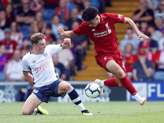 Curtis Jones and Callum Styles in action during the pre-season friendly between Bury and Liverpool on July 14, 2018