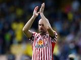 Sunderland's Darron Gibson applauds the fans on August 13, 2017