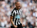 Newcastle United's Dwight Gayle celebrates scoring against Chelsea on May 13, 2018