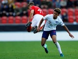England's Dylan Crowe in action with Switzerland's Jan Wornhard on May 10, 2018
