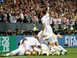 England players celebrate Kieran Trippier's opening goal in their World Cup semi-final with Croatia on June 11, 2018