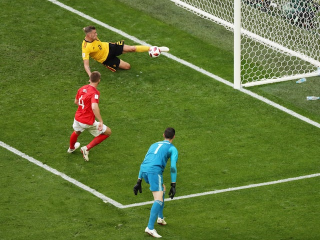 Eric Dier has his shot cleared off the line by Toby Alderweireld during the World Cup third-place playoff between Belgium and England on July 14, 2018