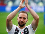 Juventus striker Gonzalo Higuain applauds fans at the end of the 2017-18 Serie A season