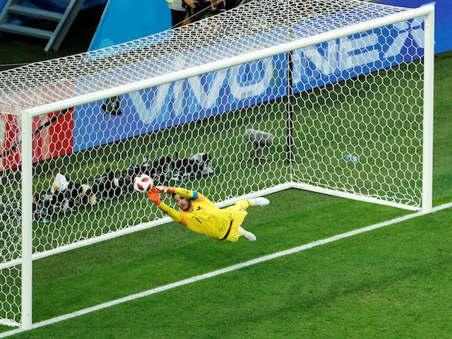 France goalkeeper Hugo Lloris makes a save during his side's World Cup semi-final with Belgium on July 10, 2018