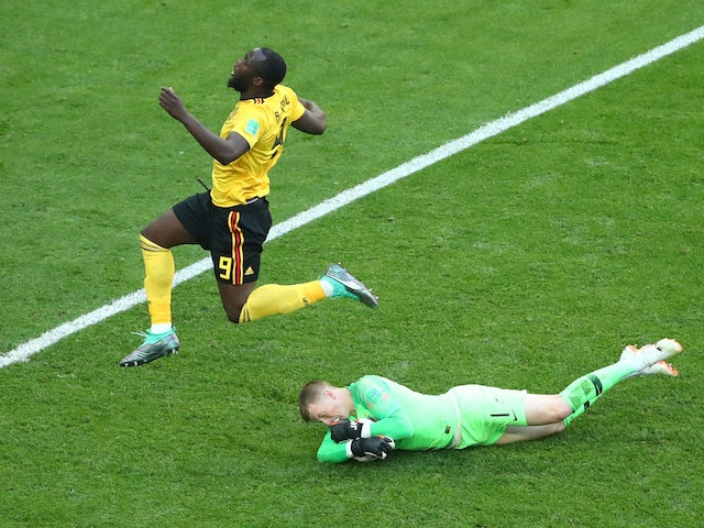 Jordan Pickford makes a save from Romelu Lukaku during the World Cup third-place playoff between Belgium and England on July 14, 2018