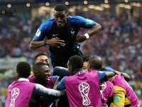 Kylian Mbappe celebrates scoring his side's fourth during the World Cup final between France and Croatia on July 15, 2018