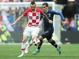 Marcelo Brozovic and Antoine Griezmann in action during the World Cup final between France and Croatia on July 15, 2018