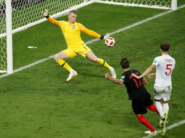 Croatia striker Mario Mandzukic scores the winning goal in the World Cup semi-final against England on July 11, 2018