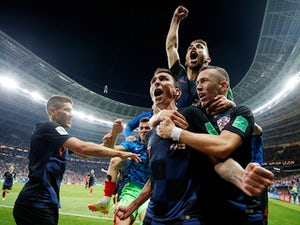 Croatia players celebrate with Mario Mandzukic after scoring the winning goal in their World Cup semi-final with England on July 11, 2018