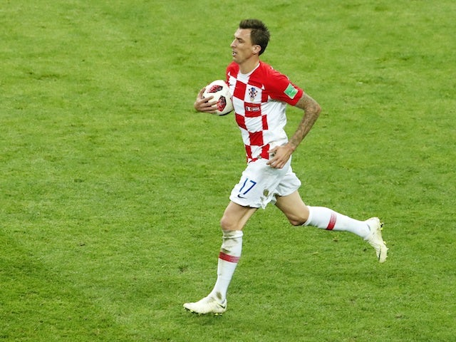 Mario Mandzukic scores for his own side during the World Cup final between France and Croatia on July 15, 2018