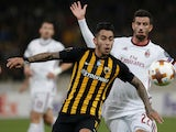 AEK Athens' Sergio Araujo in action with AC Milan's Mateo Musacchio on November 2, 2017