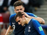 Olivier Giroud congratulates Antoine Griezmann after his penalty goal during the World Cup final between France and Croatia on July 15, 2018