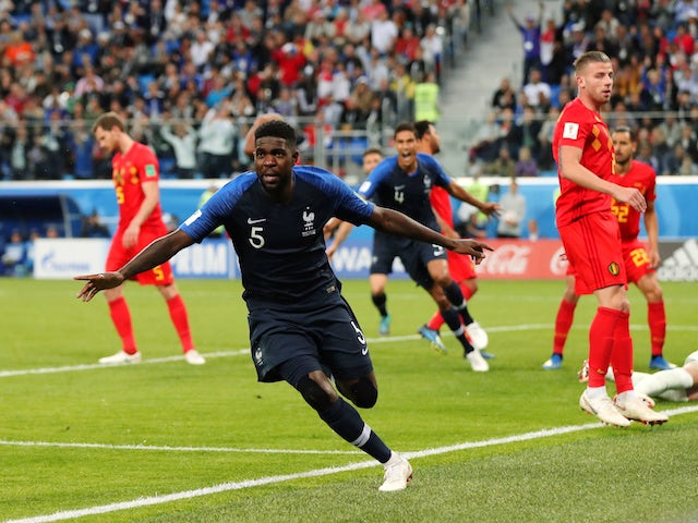 France defender Samuel Umtiti wheels away in celebration after scoring the opening goal of his side's World Cup semi-final with Belgium on July 10, 2018