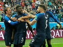 France defender Samuel Umtiti celebrates with teammates after scoring the opening goal of his side's World Cup semi-final with Belgium on July 10, 2018