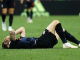 Croatia defender Sime Vrsaljko lies injured on the floor during his side's World Cup quarter-final with Russia