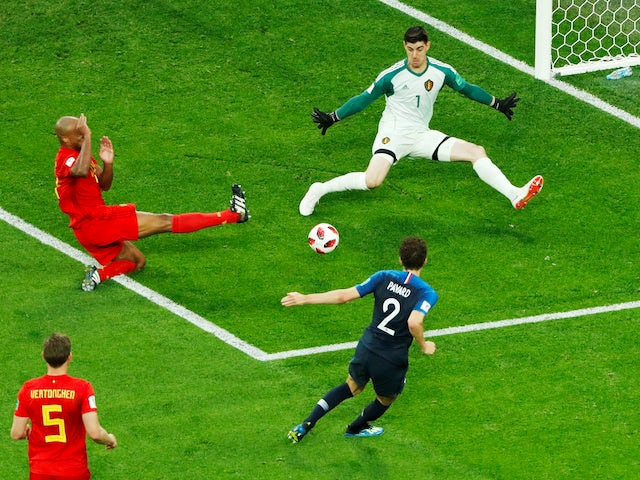 Belgium goalkeeper Thibaut Courtois denies Benjamin Pavard during the World Cup semi-final against France on July 10, 2018
