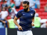Adil Rami warms up for France at the World Cup on June 30, 2018