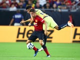 Ander Herrera and Joe Corona in action during the pre-season friendly between Club America and Manchester United on July 19, 2018