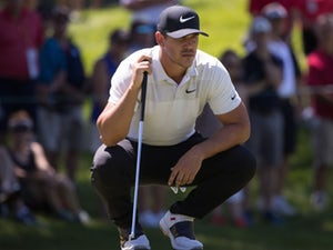 Koepka holds off Woods to win US PGA Championship