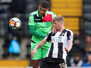 Notts County's Jonathan Stead in action with Oxford City's Christian Oxlade-Chamberlain on December 2, 2017