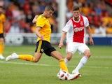 Conor Coady and Klaas-Jan Huntelaar in action during the pre-season friendly between Ajax and Wolverhampton Wanderers on July 19, 2018