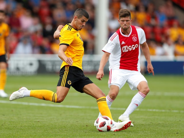 Conor Coady and Klaas-Jan Huntelaar in action during the pre-season friendly between Ajax and Wolverhampton Wanderers on July 19, 2018