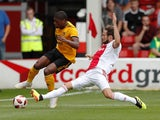 Daley Blind slides in on Ivan Cavaleiro during the pre-season friendly between Ajax and Wolverhampton Wanderers on July 19, 2018