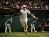 John Isner in action at Wimbledon on July 13, 2018