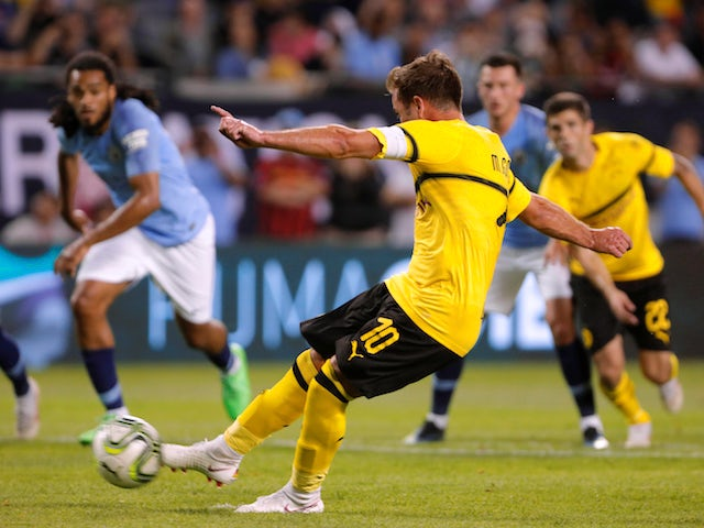 Mario Gotze scores a penalty during the pre-season friendly between Manchester City and Borussia Dortmund on July 20, 2018
