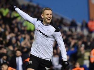 Burnley sign Derby striker Vydra