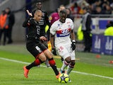 Stade Rennes's Wahbi Khazri in action with Lyon's Tanguy Ndombele on February 11, 2018