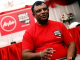 Queens Park Rangers owner Tony Fernandes sports a delightful red T-shirt at a press conference on May 15, 2018