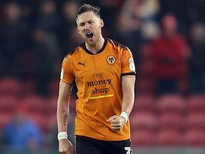 Wolves director defends Douglas sale