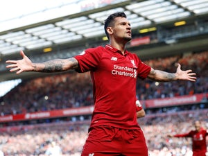 Self-proclaimed world's greatest defender Dejan Lovren basks in the Anfield glory during a match for Liverpool in May 2018