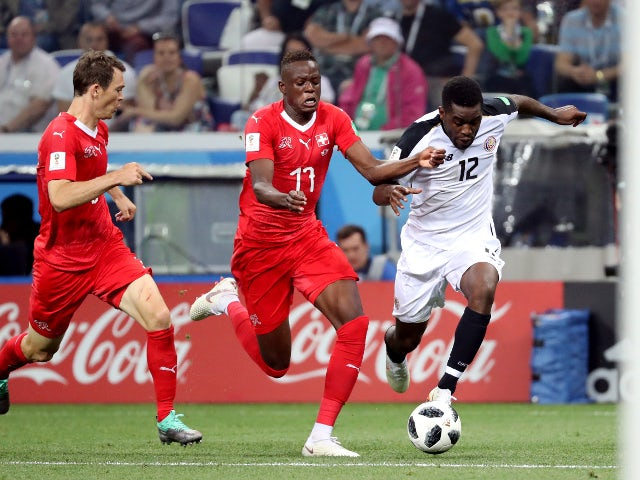 Costa Rica's Joel Campbell in action with Switzerland's Denis Zakaria on June 27, 2018