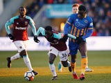 West Ham United's Domingos Quina in action with Shrewsbury Town's Arthur Gnahoua on January 7, 2018