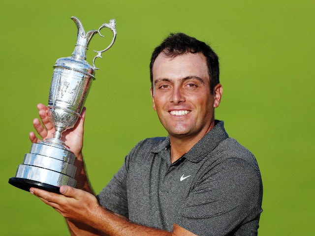 Italy's Francesco Molinari celebrates with the Claret Jug after winning the 147th Open Championship on July 22, 2018