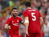 Aberdeen's Graeme Shinnie reacts with Scott McKenna during their Europa League qualifying clash with Burnley on July 26, 2018