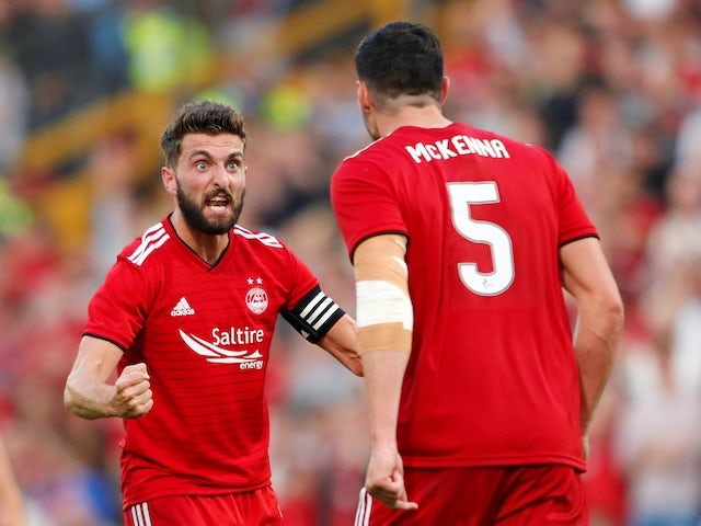 Aberdeen's Graeme Shinnie reacts with Scott McKenna during their Europa League qualifying clash with Burnley on July 26, 2018
