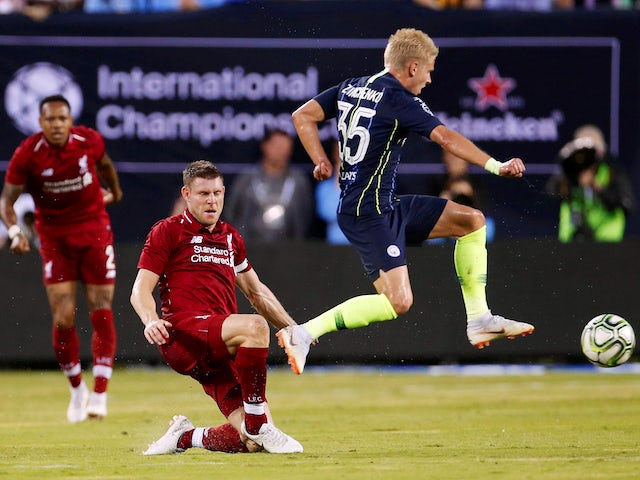 James Milber and Oleksandr Zinchenko in action during the pre-season friendly between Liverpool and Manchester City on July 25, 2018